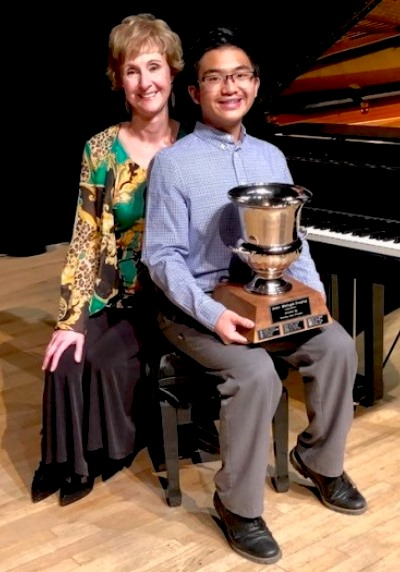 Seanne with John Melnyk trophy for most outstanding performance of a piano concerto